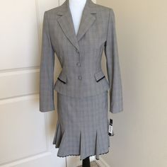 Antonio Melani Suit 2 piece plaid suit has the following features: Jacket - Three button front closure includes two faux front pockets with lace trimming, 4 buttons on sleeve, measures 22 inches from shoulder. Size 8.  Skirt - Flares out at the hem and includes lace trimming, back zip closure, measures 22 inches. Size 10.  Brand new with tags.  Never worn.  In excellent condition. ANTONIO MELANI Dresses