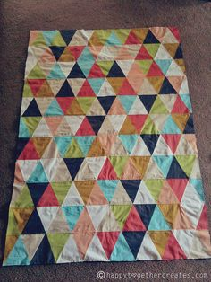 @Jessica Fediw  has a baby quilt pattern that's as colorful as it is easy. Instead of making quilt blocks, this tutorial shows you how you can piece together a project simply with triangles. Pick a color scheme that matches your baby's room and get to work on their new baby quilt for the nursery.
