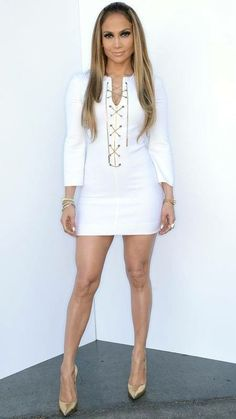 8c923288df9e9 Jennifer Lopez's Head-to-Toe Looks From American Idol - MAY 2014 Lopez was  white hot in a chain front Michael Kors dress with gold Casadei pumps.