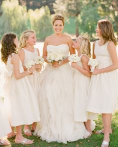 Pretty flower girls pose with bride Jessica