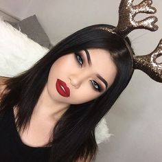 """Joy to the world and sleigh the day! Merry christmaxxxxx everyone of you beauties! Rocking my red holiday lips this year with @anastasiabeverlyhills liquid lipstick in """"Sarafine""""  wishing everyone a beautiful Christmas with family and a wonderful celebration to the end and a new upcoming year! #Anastasiabeverlyhills #liquidlipstick"""