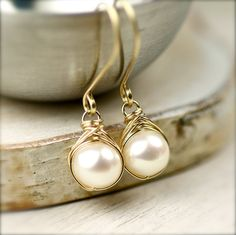 White Freshwater Pearls Wire Wrapped Earrings 14K Gold Fill. $35.00, via Etsy.
