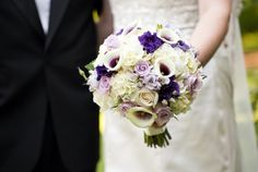 The bridesmaids will carry small bouquets of white hydrangea, purple lisianthus, blue wax flower, lavender spray roses, and gray dusty miller wrapped in purple ribbon with the stems showing