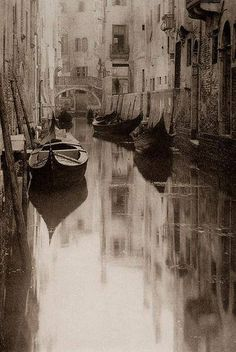 """""""Venetian Canal"""" (1894) by Alfred Stieglitz. Photograph. love where the image is focused in and how the shadows in the water appear"""