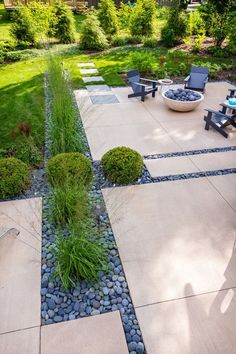 Inspiration for a mid-sized modern backyard concrete patio remodel in Milwaukee with a fire pit Concrete Paver Patio, Outdoor Patio Pavers, Concrete Patio Designs, Backyard Patio Designs, Modern Backyard, Patio Ideas, Landscaping Austin, Backyard Landscaping, Pool Backyard