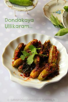 Stuffed Ivy Gourd   Dondakaya Ullikaram Tindoora – ½ kg Onion big -2 Dried red chillies – 10 Coriander chopped – 3 tbsp Green chillies slit -3 Garlic chopped – 5 pods Curry Leaves – 2 springs Mustard and Bengal gram – 1 tbsp Oil – 5 tbsp Salt to taste Water and turmeric for boiling ivy gourd