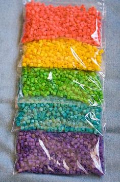 Colored pasta beads- 1 c. pasta (per color) + 2 T. rubbing alcohol + 2-3 drops food coloring