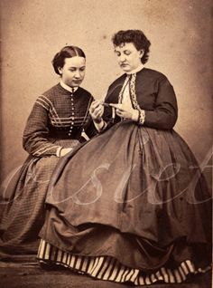 I LOVE the hitched up skirt, the zouave jacket, and above all, that striped petticoat showing! What a refreshingly dashing outfit.