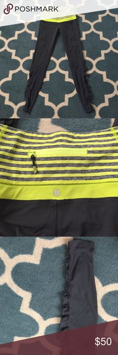 Lululemon workout pants High waisted work out pants by Lululemon. They are a darker gray with lime green and heather gray stripes at the top. There is a back pocket in the waistband. Scrunching on the bottom of the legs. EUC I think I wore them once. There are a few popped stitches as pictured they don't impact anything. lululemon athletica Other