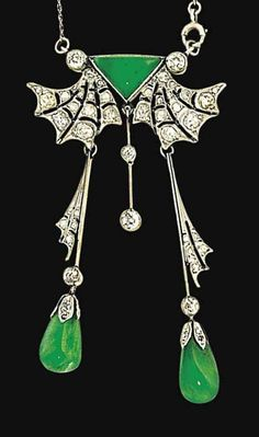 A Belle Epoque jadeite jade and diamond pendant necklace  The pendant designed as a triangular cabochon jade, suspending two millegrain-set old brilliant-cut diamonds, between old brilliant-cut diamond-set stylised bat wings, each suspending a diamond-set bar spacer terminating in a capped jade drop, to a fine trace link chain set at intervals with cabochon jade spacers