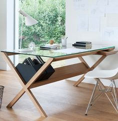 I like this desk with an area to keep magazine holders underneath