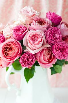 Bouquet of roses in varying shades of pink look great in a simple white jug.