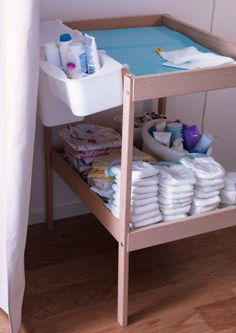 SNIGLAR changing table with LÄTTSAM plastic storage baskets ready for a change