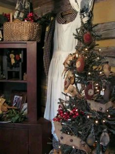 prim twiggy tree wrapped with burlap and tiny rusted bells. Log Cabin Christmas, Prim Christmas, Christmas Mood, Country Christmas, Simple Christmas, All Things Christmas, Christmas Images, Primitive Christmas Decorating, Christmas Decorations