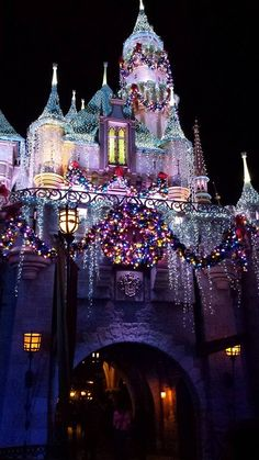 Christmas time at Disneyland at night. I miss gazing up at this castle in Disney, its' so pretty.