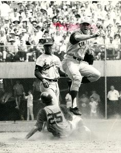 Pete Rose turning two in the 1965 All Star Game, Maury Wills with the feed.