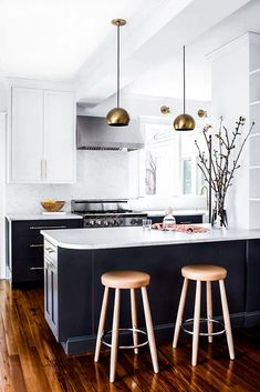Like this Euro contemporary look mixed with wood floors in antique setting...esp white tops, colorful bottom cabinets, and steel hood vent above stove