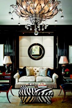 That chandelier is gorgeous!  Love the high gloss walls and tufted wall niche.