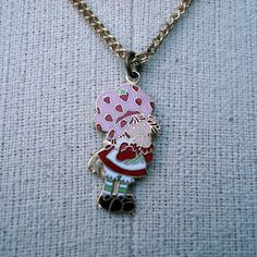 Wow they call the 80's vintage. I guess I'm vintage now. Strawberry Shortcake Necklace Vintage 1980s by purevintageclothing. I had that!