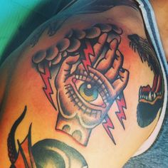 Traditional all-seeing eye in hand by Spencer Evans at Showdown; Edmonton, Alberta, Canada.