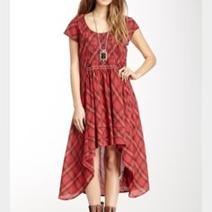 NWT Free People hi-low red plaid dress. Never worn and tags still attached. Very flowy but doesn't overwhelm the body with fabric. Matching slip comes with it so no need to worry about sheerness. Free People Dresses High Low