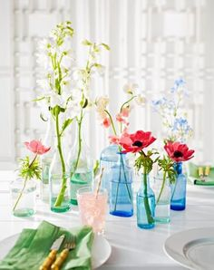 Easy flower centerpiece: Create an inexpensive centerpiece from single stems displayed in mixed glassware. More spring centerpiece ideas: http://www.midwestliving.com/homes/seasonal-decorating/50-bright-and-easy-spring-decorating-ideas/?page=3