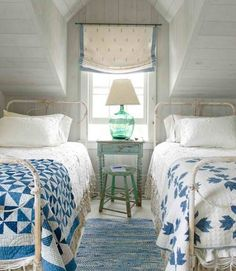 white iron beds, blue & white quilts
