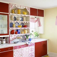 Playing with Paint---Scallops and squiggles and flowers -- oh my! Plain-vanilla cabinets go cherry red in this whimsical painting project. Collectible pottery adds another focal point.