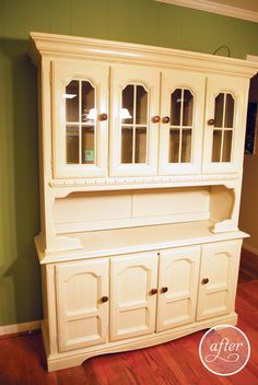 This exact one is for sale on craigslist for $100.  A redo of an old 70's china cabinet
