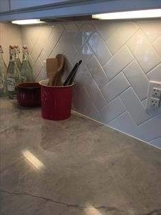 Kitchen backsplash: White Subway Tile in Herringbone pattern