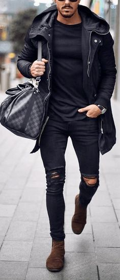 Men's fall or winter style trends. Black jacket with black ripped jeans, black shirt and brown boots. #mensfashion #menswear #menstyle #mensguides #streetstyle #streetwear #fashion #falloutfits #winteroutfits #giorgentiweddings