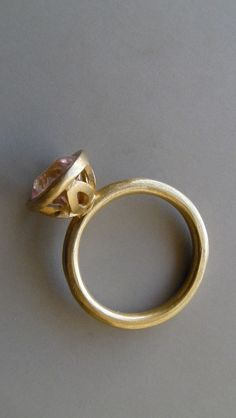 gold and pink ring