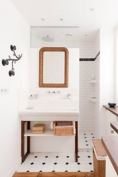 Walk-in shower behind vanity wall - no glass to clean!  Love the wall hooks.