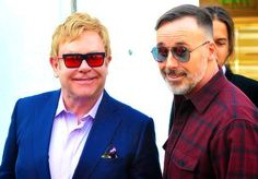 Elton John & David Furnish model sunglasses on a recent shopping trip on Rodeo Drive