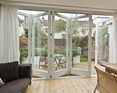 Modern Rear Extension Design in Contemporary Style : Awesome Family Room With Glass Folding Door Rear Extension And House Remodelling