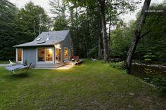 Private streamside designer cottage in Woodstock woods.