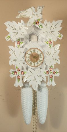 This charming and inexpensive #cuckoo #clock has leaves and a bird that are hand carved from solid Linden wood. When the clock strikes the hour or half-hour, the door opens, a cuckoo appears and calls along with the clocks gong strike. This clock is hand made in Germany.
