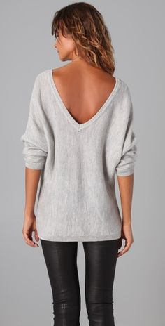 Liquid leggings and oversized grey low-back sweater.