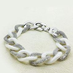 Lovely Ceramic Bold Chain Bracelet @ https://www.gokoco.com/gkc/fashion-jewelry/bracelets/ceramic-bold-chain-bracelet-with-crystal-cubic-zirconia-loop-white-gold-coating.html #ceramicboldchainbracelet #custombracelets #crystalbracelets
