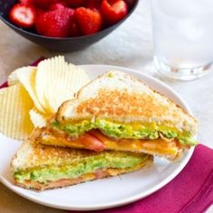 A Grilled Cheese filled with crispy bacon, buttery avocado, and sweet juicy tomatoes!