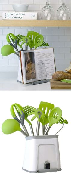 I keep all of my utensils in the drawer but this is cool.  Kitchen Utensil & CookBook Holder