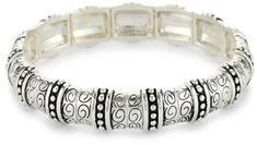 Napier Silver-Tone Textured Stretch Bracelet. Textured silver stretch bracelet, one size fits most. Classic casual silver styling to match any outfit. Imported.