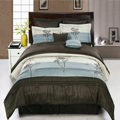 12 Piece Luxury Bedding Set. The colors of this set are combination Aqua blue metallic and Coffee Brown with White sheet set.