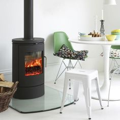 The Morso 6140 is a minimalist wood burning stove in timeless design, with a large glass door that provides a splendid view of the dancing flames Plywood Furniture, Furniture Design, Coffee Table Design, Morso Stoves, Morso Wood Stove, Wood Fuel, Freestanding Fireplace, Pellet Stove, Architecture Tattoo