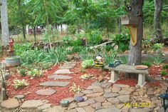 Rock garden entrance, would love to replace mulch with lava rock. VERY low maintenance.