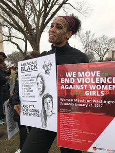 """A demonstrator displays a sign declaring """"America is black...and it's not going anywhere,"""" at the Women's March on Washington, Saturday, Jan. 21, 2017."""