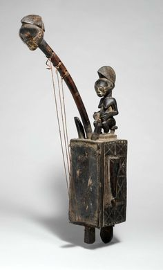 Africa | Harp from the Baule culture, Ivory Coast | Wood and hide | late 19th century
