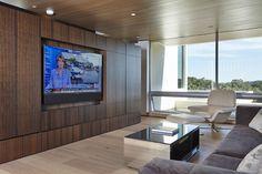 Hidden TV in custom wood wall
