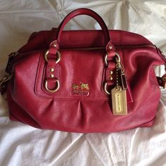 % Authentic COACH Madison Satchel/Hobo % Authentic COACH Madison Satchel/Hobo in a buttery leather watermelon/ raspberry color. Excellent pre loved condition, some normal wear on the hardware. This bag is rare and coverts from hobo to satchel!  ⛔️NO TRADES OR PAYPAL⛔️NO LOWBALL OFFERS✨Willing to bundle so ask, ALL OFFERS DONE USING THE BUTTON ✨         REMEMBER POSH TAKES 20%⚠️Ask all questions as sales are FINAL⚠️ Coach Bags Hobos