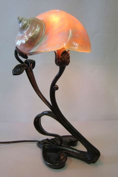 Art Nouveau Shell Lamp | From a unique collection of antique and modern table lamps at https://www.1stdibs.com/furniture/lighting/table-lamps/